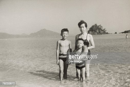 Mother and sons at seaside : Stock Photo