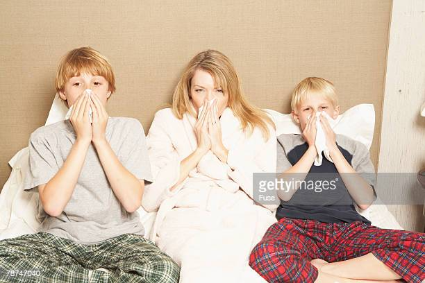 Mother and Sons Ill in Bed