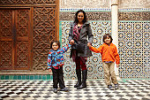 Mother and sons in Moroccan building