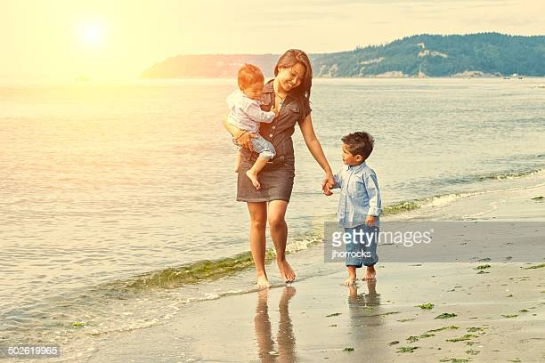 Mother and Sons Walking on Seattle Beach at Sunset