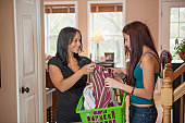Mother and Teen Daughter with Laundry Basket