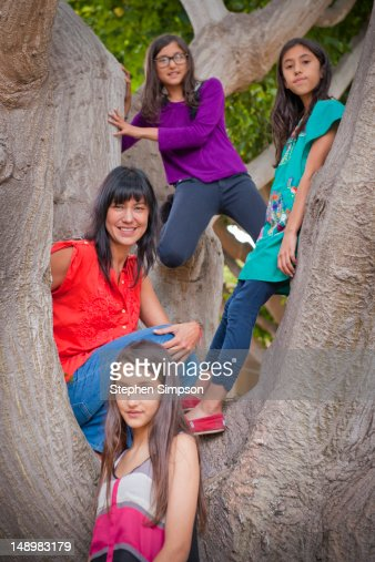 mother and three daughters, portrait in a tree : Stock Photo