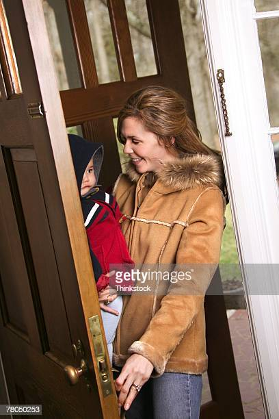 Mother and toddler coming through doorway
