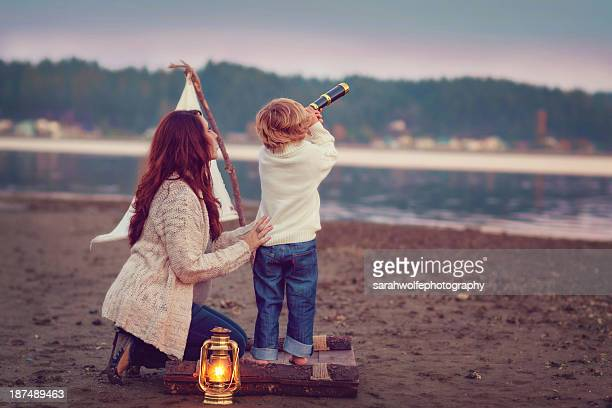 Mother and toddler looking out over the ocean