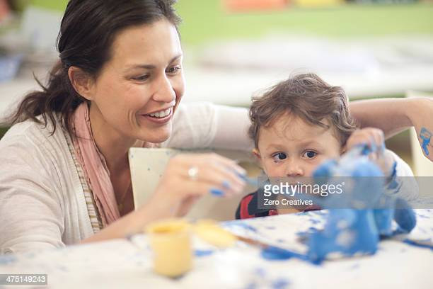 Mother and toddler painting in art class