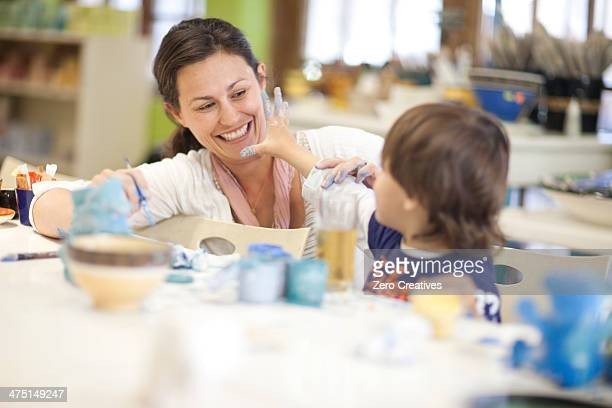 Mother and toddler playing in art class