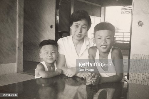 Mother and two sons : Stock Photo