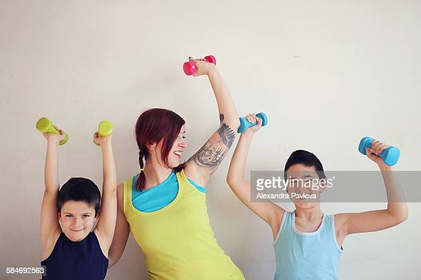 Mother and two sons working out