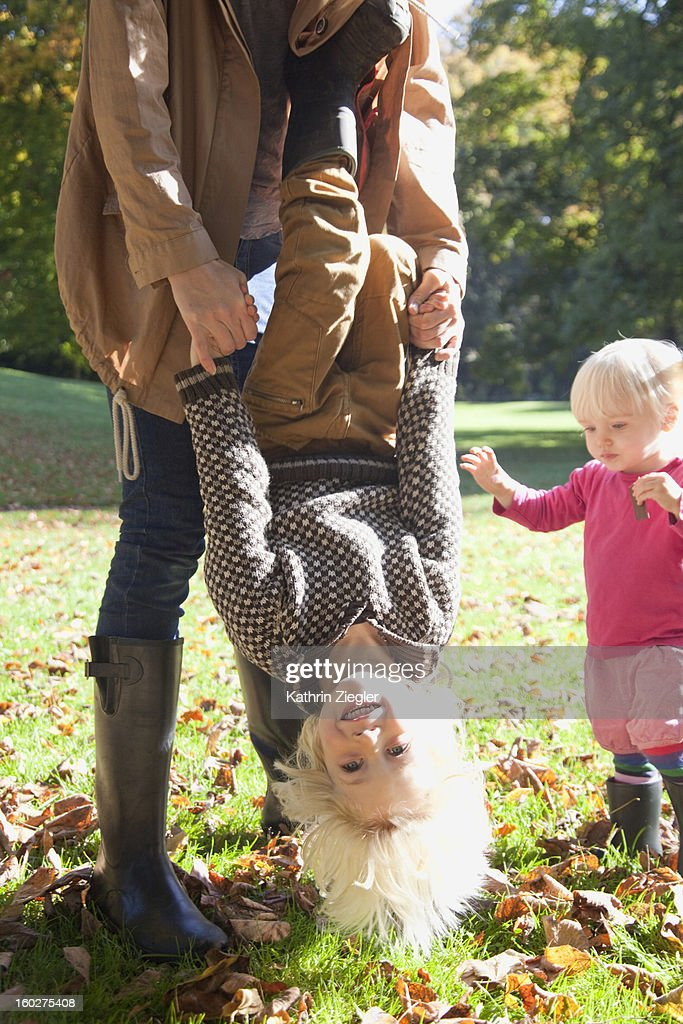 mother and two young children playing in the park : Stock Photo