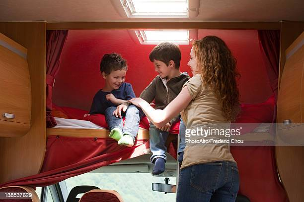 Mother and young boys in motor home