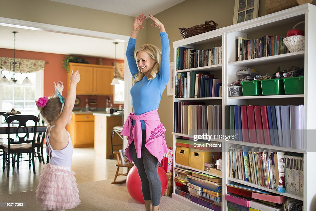 Mother and young daughter practicing ballet : Stock Photo