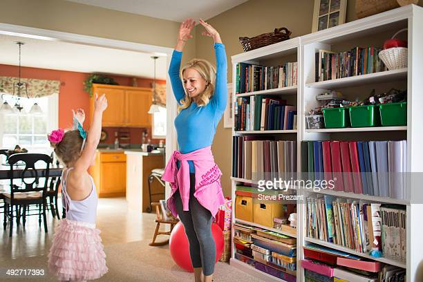 Mother and young daughter practicing ballet