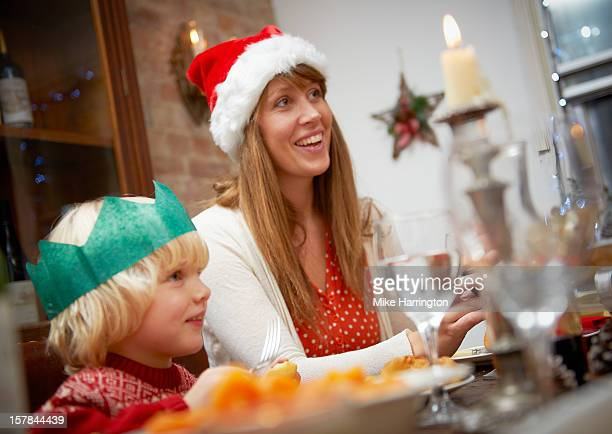 Mother and young son at dining table at Christmas