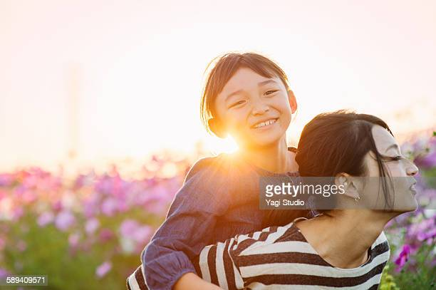 Mother and daughter are in the cosmos field