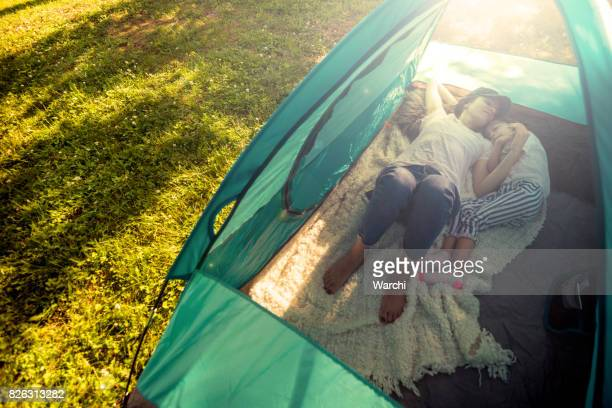 mother ant daughter having fun in camping the tent