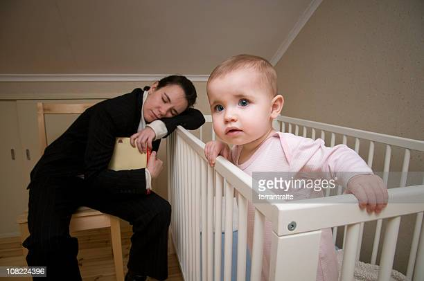 Mother Asleep on Crib with Baby Awake and Watching