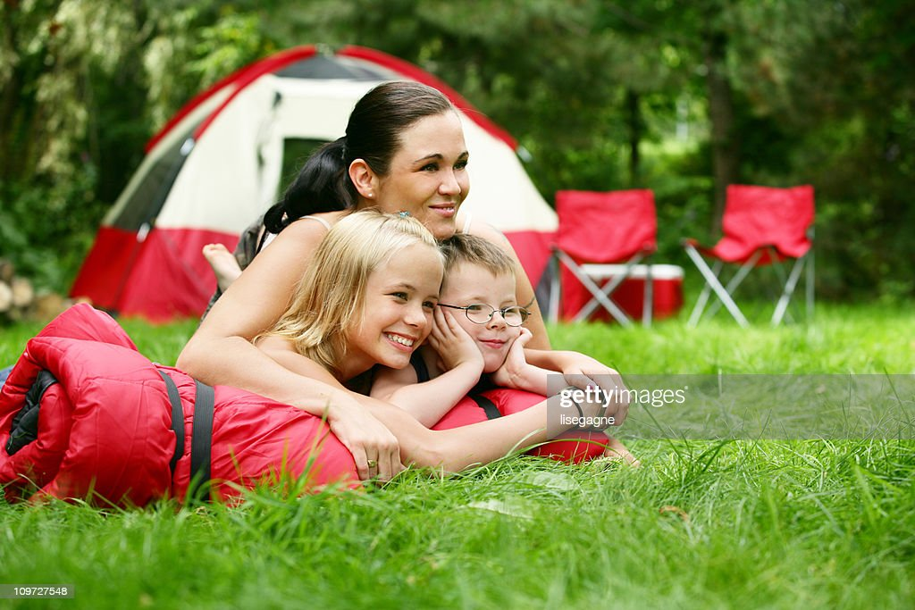 Mother at camping site with family : Stock Photo