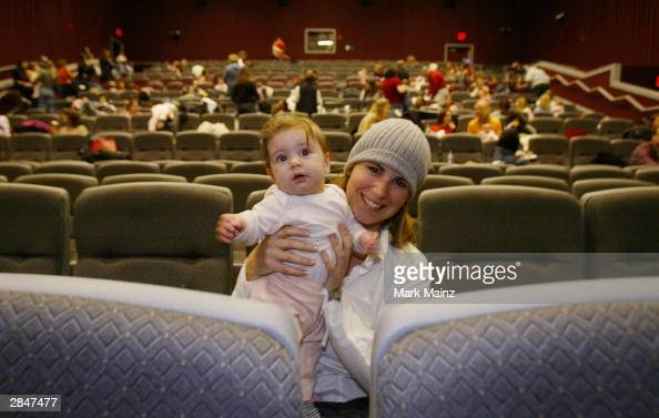 Mother Aviva Nagel and her 6monthold daughter Aliya attend a screening of 'Cold Mountain' at Leows Movie Theater on 34th Street January 6 2003 in New...