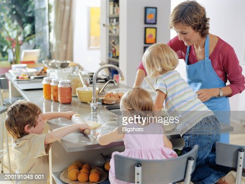 Mother baking with boy and girl (3-5) and girl (15-18 months) : Stock Photo
