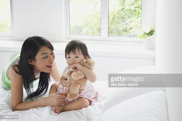Mother bonding with young daughter