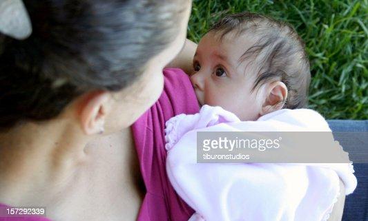 Mother Breastfeeding / Nursing Baby in the Park