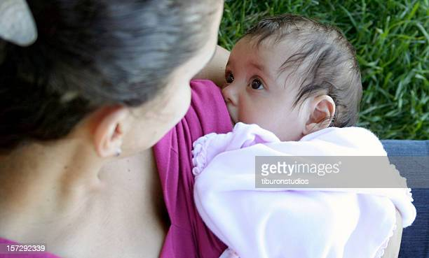 Mother Breastfeeding / Nursing Baby in the Park