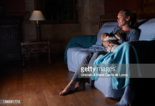 Mother breastfeeding with television