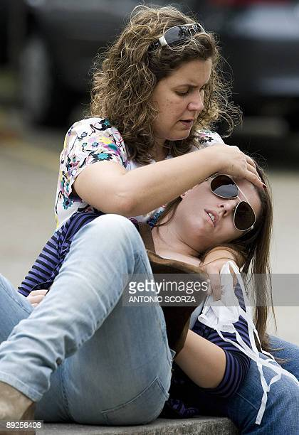 STORY A mother cares her daughter as they wait to receive medical attention in Rio de Janeiro on July 23 2009 Authorities said the number of deaths...