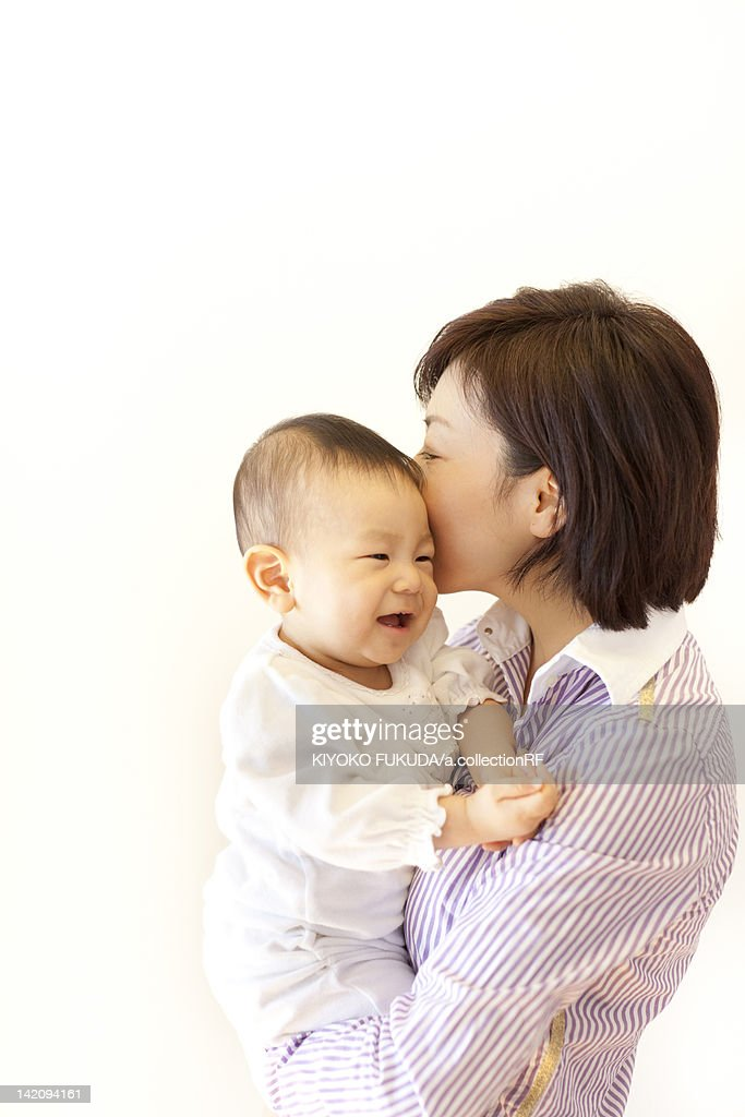 Mother carrying baby girl : Stock Photo
