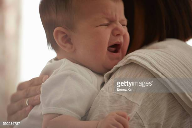 Mother carrying crying baby