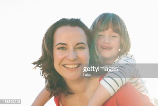 Mother carrying daughter outdoors : Stock Photo
