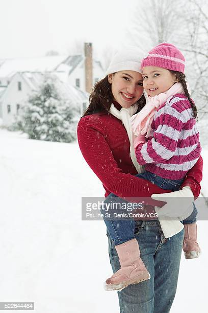 Mother carrying daughter