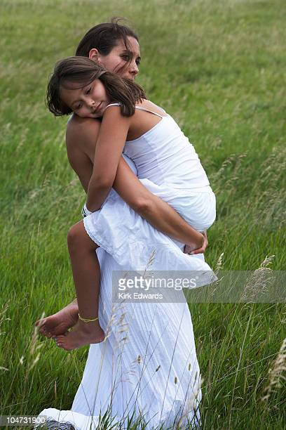 Mother carrying her child