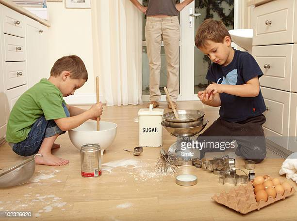 Mother catching twins baking and messing floor