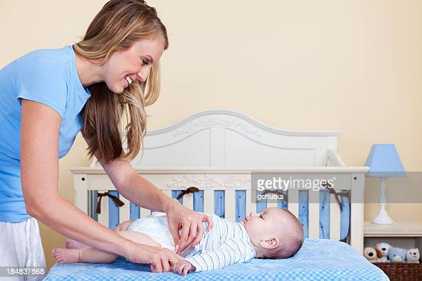 Mother Changing Baby Diaper