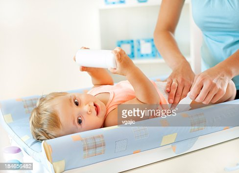 Mother Changing baby Girl Diaper