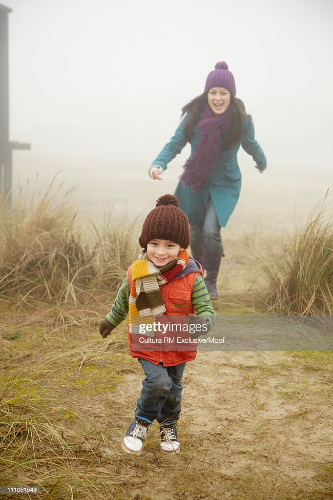 Mother chasing son outside