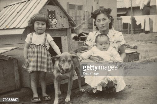Mother, children and pet dog : Stock Photo