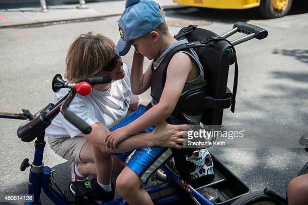 A mother comforts her son during the first annual Disability Pride Parade on July 12 2015 in New York City The parade calls attention to the rights...