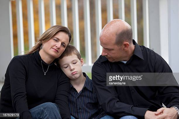 Mother consoles Son with Father, young family portrait Autumn