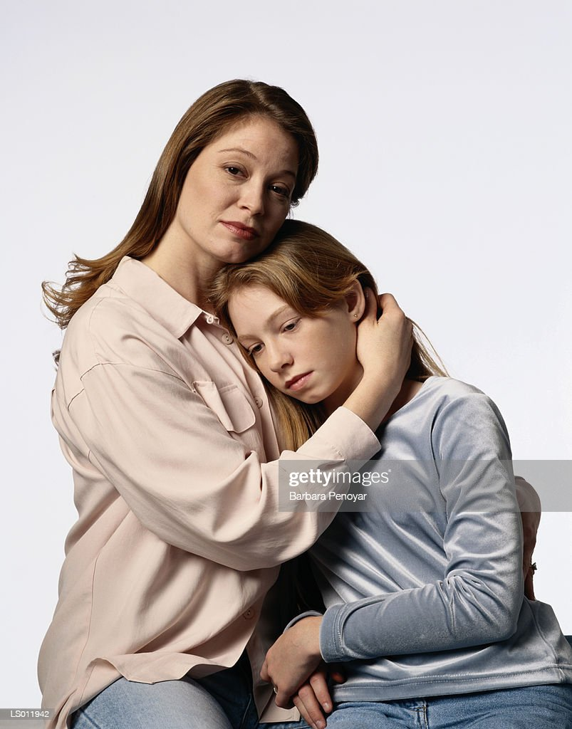 Mother Consoling Daughter : Stock Photo