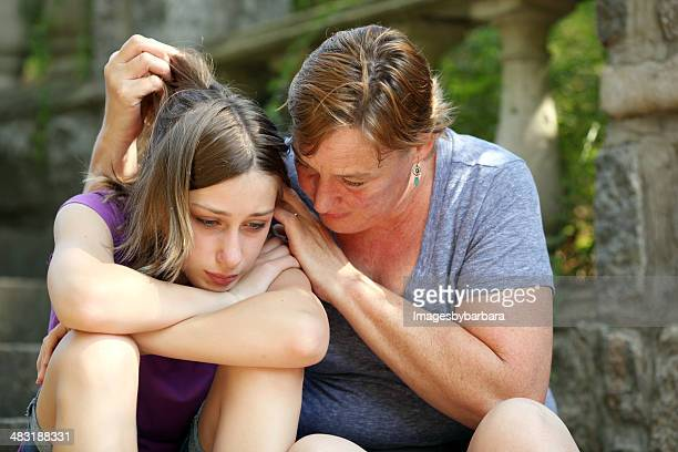 Mother consoling dejected daughter