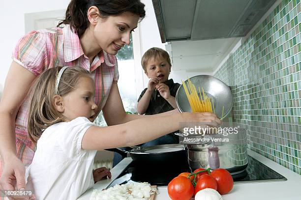 mother cooking with her children