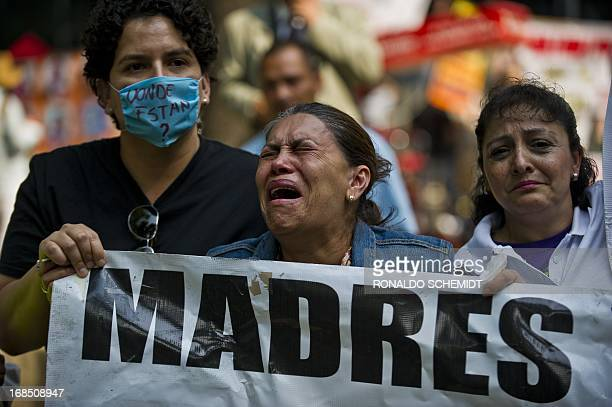 A mother cries during a protest in Mexico City on May 10 2013 A group of mothers and relatives of children missing due to the drug war in the country...