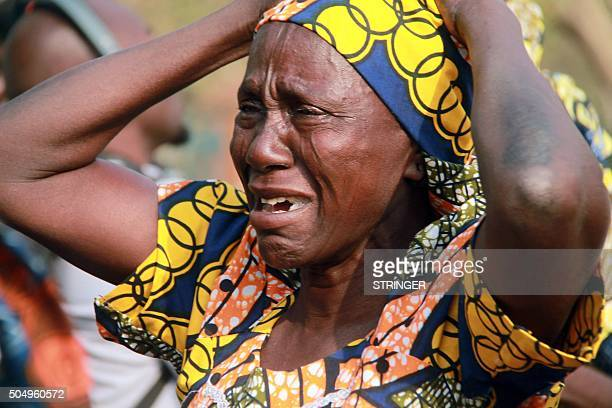 A mother cries for her missing daughter abducted in 2014 by Boko Haram Islamists during a march to press for the release of the schoolgirls kidnapped...