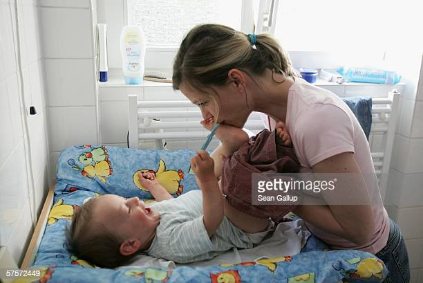 Annette Wassermann cuddles with her son Leander 16 months at home after work May 9 2006 in Berlin Germany Wassermann and her husband Kostas Kosmas...