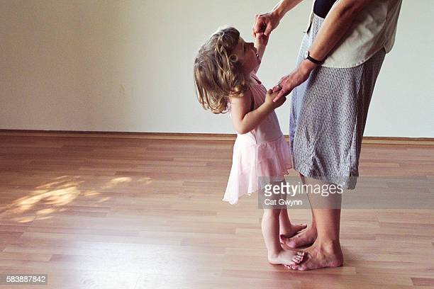 Mother Dancing with Young Daughter
