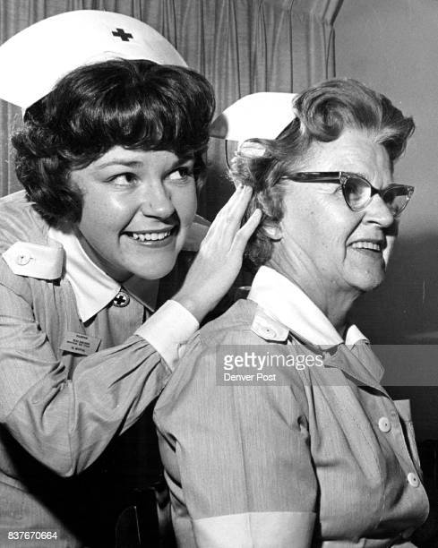 Mother Daughter Capped Mrs Seldon Robinson 2033 S St Paul St is capped as a Red Cross Grey Lady by her daughter Carol after both completed the Red...