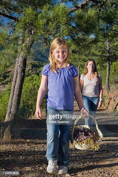 Mother & daughter collecting wild flower