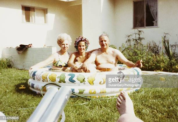 Mother, Daughter & Father in Kiddie Pool 1971